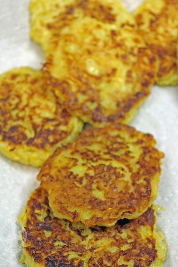 Squash fritters on th paper towels to drain the grease.