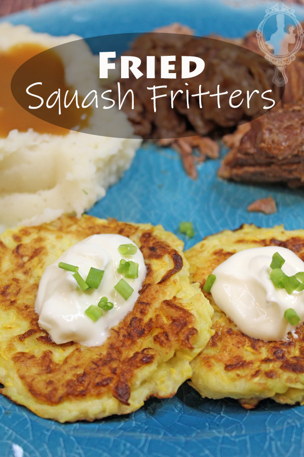 Two squash fritters on a plate with roast and mashed potatoes.