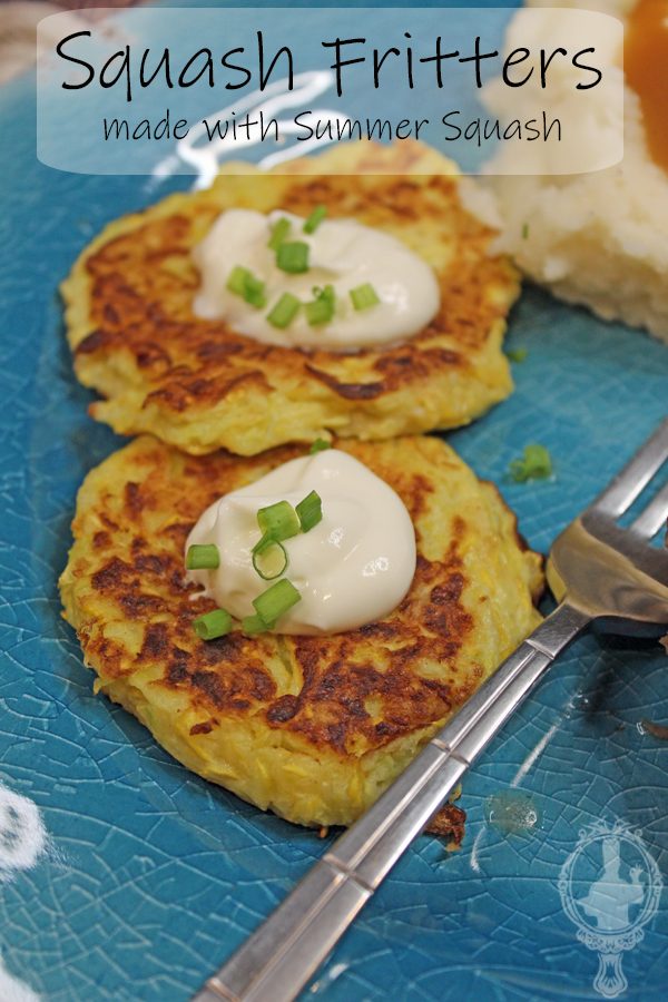 Two squash fritters with a fork, mashed potatoes in the background.