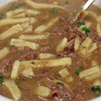 Close up of a bowl of Beef and Noodle Soup.