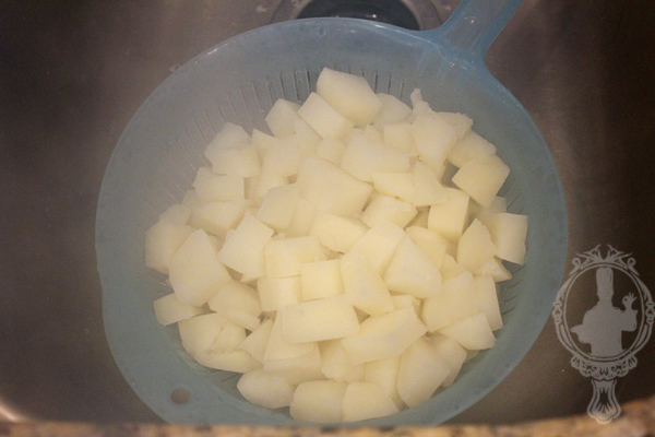 Potatoes draining in a colander.