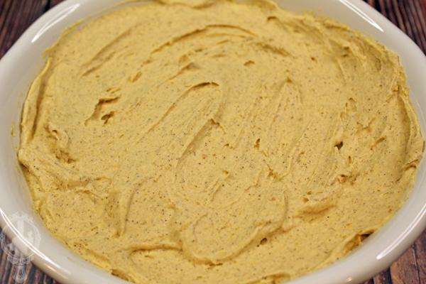 Overhead, close up of pumpkin pie dip in a serving dish.