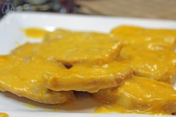 Close up of slow cooker cheesy pork chops on a serving plate.