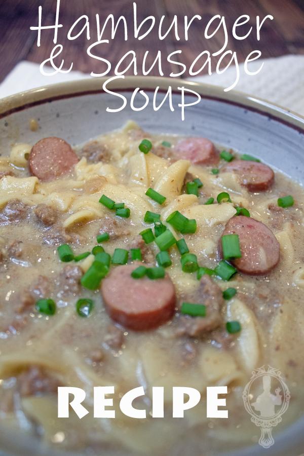 Angle shot of a bowl of hamburger and sausage soup.